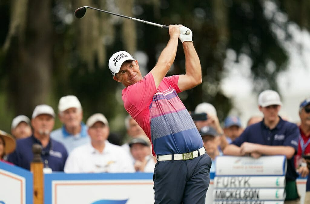 Harrington struggles on Champions debut but Clarke right in the mix